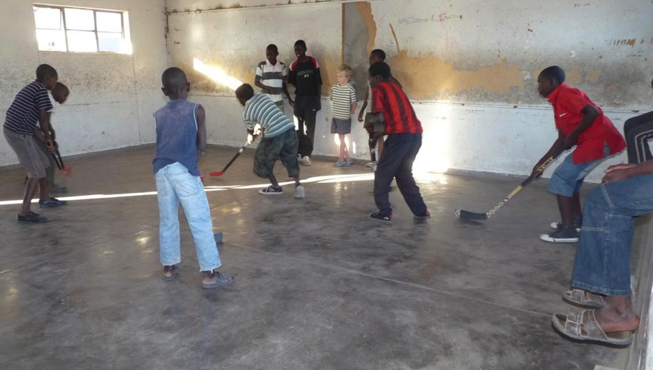 OWL Magazine reader playing hockey at a school in Namibia