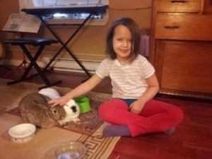 Isabel with her pet bunnies, Christopher and Myrtle.