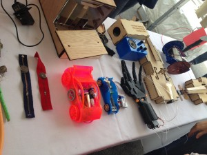 These bracelets, battery-operated cars, and remote-controlled hand were all made by high school students with a 3D printer.