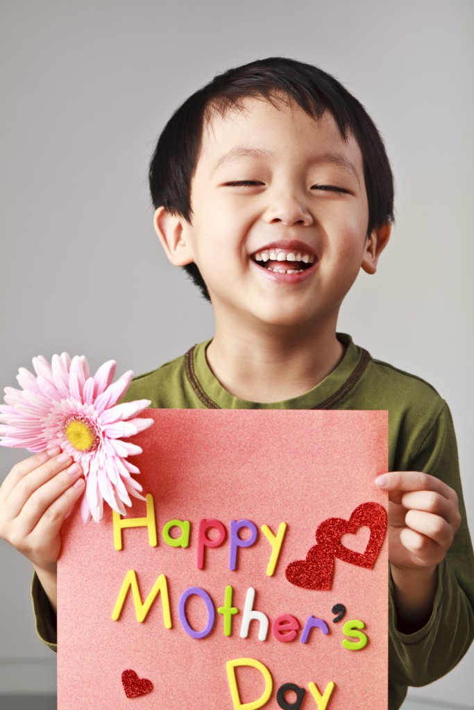 Cute boy with Mother's Day Card