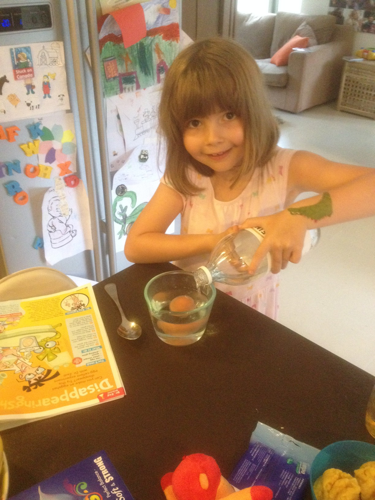 Layla, 6, doing the Disappearing Shell experiment from the April issue.