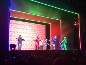 The PJ Masks on stage. Owlette, Catboy, and Gecko.
