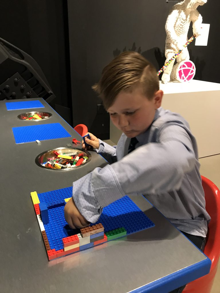 Boy working with Legos at Canadian Science and Tech Museum