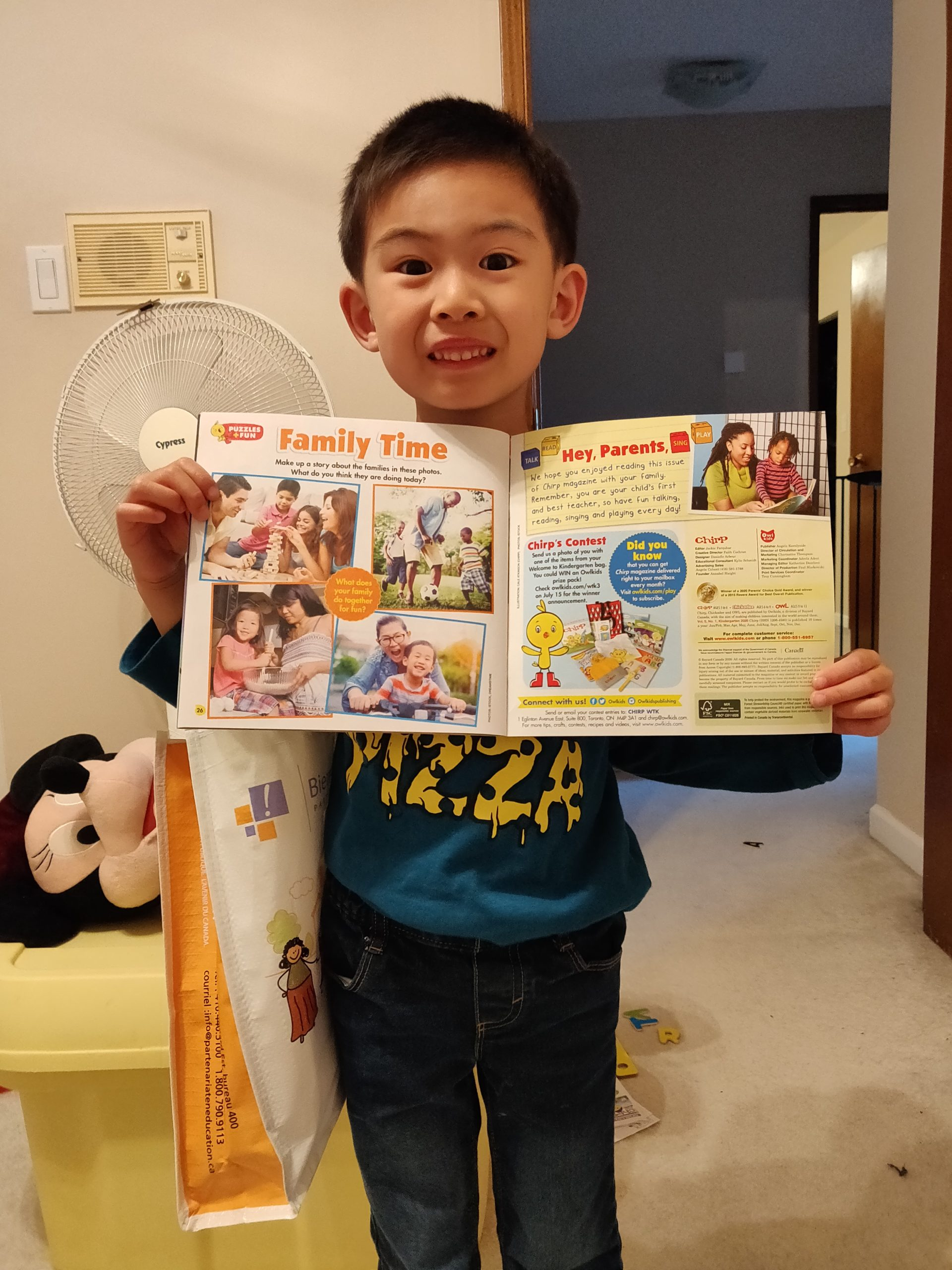 Chirp reader Lewis holding chirp magazine